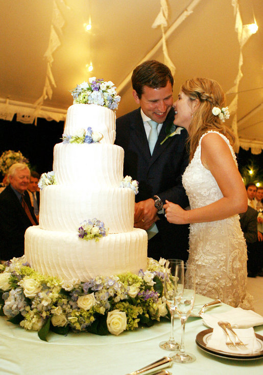 Henry and Jenna Hager pause as they cut their wedding cake Saturday, May 10, 2008, during a reception in their honor following the ceremony at Prairie Chapel Ranch near Crawford, Texas. White House photo by Shealah Craighead