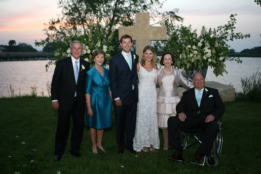 President George W. Bush and Mrs. Laura Bush and Mr. and Mrs. John Hager pose with the newly married couple, Jenna and Henry Hager, in front of the altar Saturday, May 10, 2008, after their wedding ceremony at Prairie Chapel Ranch near Crawford, Texas. White House photo by Shealah Craighead