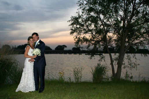Mr. and Mrs. Henry Hager pose for photographs along the lake at Prairie Chapel Ranch following their wedding ceremony Saturday, May 10, 2008, in Crawford, Texas. White House photo by Shealah Craighead