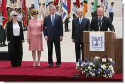President George W. Bush and Mrs. Laura Bush are joined by Mrs. Aliza Olmert, wife of Prime Minister Ehud Olmert, and Israel's President Shimon Peres as Israeli Prime Minister Olmert delivers remarks Wednesday, May 14, 2008, at arrival ceremonies for President and Mrs. Bush in Tel Aviv. White House photo by Chris Greenberg