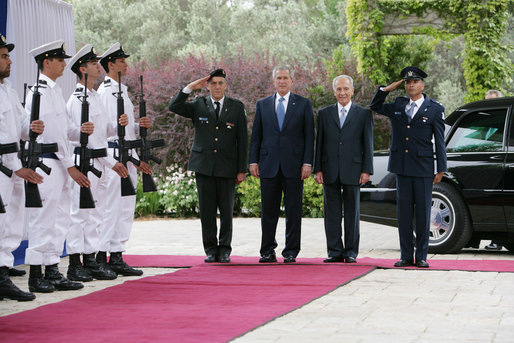 President George W. Bush and Israel's President Shimon Peres stand on the red carpet before walking through an honor guard Wednesday, May 14, 2008, at the President's Residence in Jerusalem. The two leaders met shortly after the late morning arrival by President Bush and Mrs. Laura Bush. White House photo by Chris Greenberg