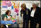 Mrs. Laura Bush and Mrs. Aliza Olmert, spouse of Israel's Prime Minister Ehud Olmert, greet a young mother in the Breast Feeding Education Room during a visit to the Tipat Chalav-Gonenim Neighborhood Mother and Child Care Center in Jerusalem Wednesday, May 14, 2008. There are 30 similar centers throughout the city providing prenatal, postnatal and preventative care and advice on breastfeeding, nutrition, immunizations and disease screening. White House photo by Shealah Craighead