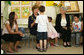 Mrs. Laura Bush shares a moment with a kindergarten student Wednesday, May 14, 2008, at the Hand in Hand School for Jewish-Arab Education in Jerusalem. Mrs. Bush took the opportunity to visit the school with Mrs. Aliza Olmert, right, spouse of Israeli Prime Minister Ehud Olmert. White House photo by Shealah Craighead
