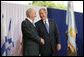 President George W. Bush and President Shimon Peres of Israel shake hands after their meeting Wednesday, May 14, 2008, in Jerusalem. White House photo by Chris Greenberg
