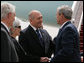 President George W. Bush is greeted by Israel's Prime Minister Ehud Olmert and Mrs. Aliza Olmert as he deplanes Air Force One Wednesday, May 14, 2008, with Mrs. Laura Bush in Tel Aviv. The President and First Lady will spend two nights in Jerusalem before continuing on to Saudi Arabia and Egypt. White House photo by Joyce N. Boghosian