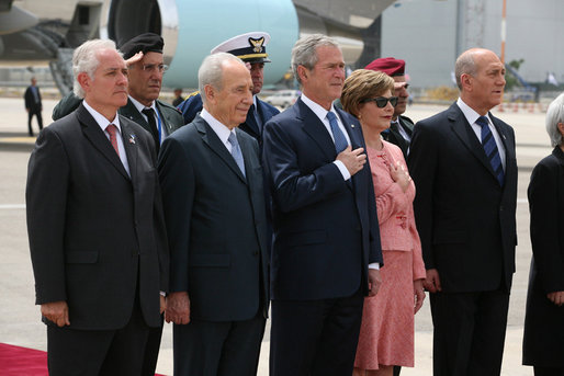 President George W. Bush and Mrs. Laura Bush are joined by Israel's Ambassador Yitzhak Eldan, left, President Shimon Peres, and Prime Minister Ehud Olmert during the playing of the national anthems Wednesday, May 14, 2008, during arrival ceremonies in honor of President and Mrs. Bush at Ben Gurion International Airport in Tel Aviv. White House photo by Joyce N. Boghosian