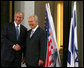 President George W. Bush and President Shimon Peres of Israel pause for photographers as they meet Wednesday, May 14, 2008, at President Peres' Jerusalem residence. White House photo by Joyce N. Boghosian