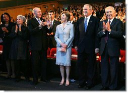 President George W. Bush and Laura Bush are applauded as they attend the Israeli Presidential Conference 2008 at the Jerusalem International Center in Jerusalem, Wednesday, May 14, 2008, during a celebration in honor of the nation's 60th anniversary. From left are U.S. Secretary of State Condoleezza Rice, Mrs. Aliza Olmert, Israeli Prime Minister Ehud Olmert, and Israeli President Shimon Peres. White House photo by Joyce N. Boghosian