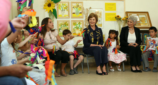 Mrs. Laura Bush joins students at Hand in Hand School for Jewish-Arab Education Wednesday, May 14, 2008, during her visit to Jerusalem. Joining her on the tour of the school that provides integrated, bilingual education to Jewish and Arab students in Israel is Mrs. Aliza Olmert, spouse of Israeli Prime Minister Ehud Olmert. White House photo by Shealah Craighead