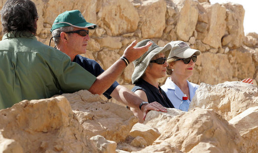 President George W. Bush and Mrs. Laura Bush stand with Mrs. Aliza Olmert, spouse of Israeli Prime Minister Ehud Olmert, as they listen to Eitan Campbell, Director of the Masada National Park, during a visit to the historic site Thursday, May 15, 2008, in Masada, Israel. White House photo by Joyce N. Boghosian