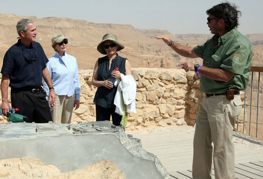 Director Eitan Campbell describes the water system of Masada to President George W. Bush, Mrs. Laura Bush and Mrs. Aliza Olmert, Thursday, May 15, 2008, as they tour the historic fortress built by King Herod of Judea, who ruled from 37 BC to 4 BC and chose the site as a refuge against his enemies and as a winter palace. White House photo by Joyce N. Boghosian
