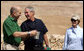 President George W. Bush and Prime Minister Ehud Olmert of Israel, share a moment as they stop during their tour of Masada with Mrs. Laura Bush to learn about the historic fortress's water system. White House photo by Joyce N. Boghosian