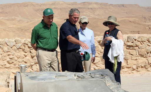Prime Minister Ehud Olmert, Mrs. Laura Bush and Mrs. Aliza Olmert listen as President George W. Bush talks about the water system at Masada, the historic fortress built by King Herod of Judea. The couple's toured the National Park Thursday, May 15, 2008, during the visit to Israel by President and Mrs. Bush to help celebrate the 60th anniversary of the country's independence. White House photo by Joyce N. Boghosian