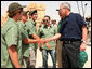President George W. Bush shakes hands with American students from Connecticut, Massachusetts and California who are volunteering at Masada National Park in Masada, Israel. The President met the young men as he toured the historic site with Prime Minister Ehud Olmert, Mrs. Laura Bush and Mrs. Aliza Olmert. White House photo by Joyce N. Boghosian