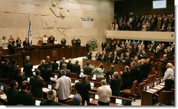 "President George W. Bush receives a standing ovation by members of the Knesset Thursday, May 15, 2008, in Jerusalem. Acknowledging the 60th anniversary of Israel's independence, the President told the Israeli parliament, ""Earlier today, I visited Masada, an inspiring monument to courage and sacrifice. At this historic site, Israeli soldiers swear an oath: ""Masada shall never fall again."" Citizens of Israel: Masada shall never fall again, and America will be at your side."" White House photo by Shealah Craighead"