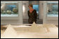 Mrs. Laura Bush looks over an exhibit at the Bible Lands Museum Jerusalem Friday, May 16, 2008, during a final stop in Israel before departing for Saudi Arabia. White House photo by Joyce N. Boghosian