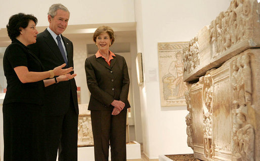 "President George W. Bush and Mrs. Laura Bush listen as they're guided through the Bible Lands Museum Jerusalem Friday, May 16, 2008, by Director Amanda Weiss. The museum illustrates the cultures of all the peoples mentioned in the Bible and was founded by the late Dr. Elie Borowski, whose motto remains, ""the future of mankind has its roots in the past, and only through understanding our history can we work together to create a better future for the generations to come"". White House photo by Joyce N. Boghosian"