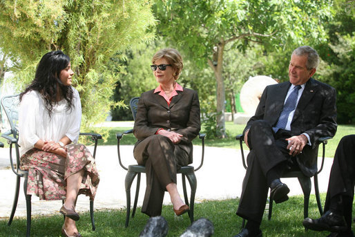 Mrs. Laura Bush and President George W. Bush listen to a young participant during a roundtable discussion Friday, May 16, 2008, in the garden of the Bible Lands Museum Jerusalem. White House photo by Joyce N. Boghosian