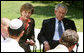 "President George W. Bush and Mrs. Laura Bush listen to as a young participant during a roundtable discussion Friday, May 16, 2008, at the Bible Lands Museum Jerusalem. On the topic of peace with the Palestinians, the young student said, ""I'm religious, but I want to give the Arabs land,'' he said. ""I feel I have a good life. Why don't they get a good life too?"" White House photo by Joyce N. Boghosian"