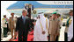 President George W. Bush and King Abdullah bin Abdulaziz walk the red carpet after the arrival Friday, May 16, 2008, of the President and Mrs. Laura Bush to Riyadh. As guests of the King, the President and Mrs. Bush will overnight at his Al Janadriyah Ranch before continuing on their Mideast Visit Saturday to Egypt. White House photo by Joyce N. Boghosian
