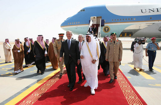 President George W. Bush and King Abdullah bin Abdulaziz walk with an entourage of greeters Friday, May 16, 2008, after the President's arrival at Riyadh-King Khaled International Airport in Riyadh. White House photo by Joyce N. Boghosian