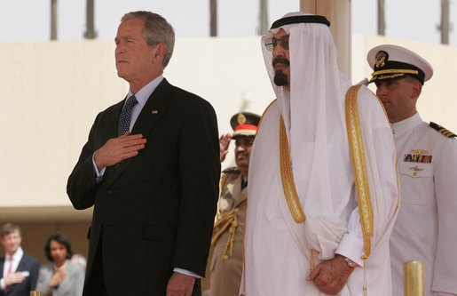President George W. Bush and King Abdullah bin Adbulaziz pause for the playing of their respective national anthems Friday, May 16, 2008, during arrival ceremonies for the President and Mrs. Laura Bush at Riyadh-King Khaled International Airport in Riyadh. White House photo by Joyce N. Boghosian