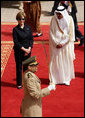 Mrs. Laura Bush and President Bush are greeted by Saudi delegation members during arrival ceremonies Friday, May 16, 2008, at Riyadh-King Khaled International Airport in Riyadh. White House photo by Shealah Craighead