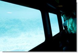 Mrs. Laura Bush looks out from underwater windows during her coral reefs and ocean conservation tour Saturday, May 17, 2008, in Sharm El Sheikh, Egypt. White House photo by Shealah Craighead