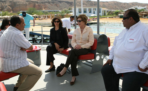 Mrs. Laura Bush listens to Dr. Mohamed Salem, Head of the South Sinai Protectorates, Egyptian Environmental Affairs Agency, as they prepare to depart for a coral reefs and ocean conservation tour Saturday, May 17, 2008, in Sharm El Sheikh, Egypt. Joining them are Ms. Hilda Arellano, USAID Cairo Mission Director, and Mr. Amir Ali, Hurghada Environmental Protection and Conservation Association. White House photo by Shealah Craighead