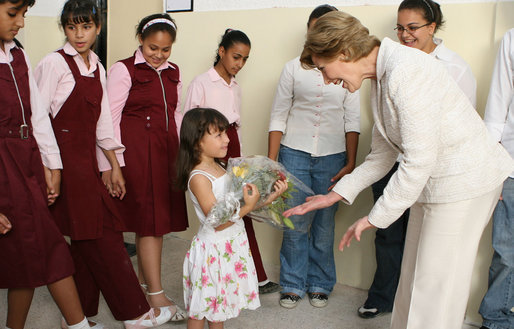 A young girl presents Mrs. Laura Bush with flowers before her departure Sunday, May 18, 2008, following a roundtable discussion with students on Big Read Egypt/U.S. at the Fayrouz Experimental School for Languages at Sharm El Sheikh. White House photo by Shealah Craighead