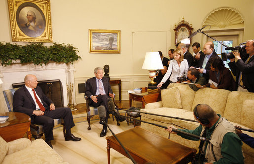 President George W. Bush is joined by U.S. Treasury Secretary Henry Paulson Monday morning, May 19, 2008, in the Oval Office, where President Bush told reporters he looks forward to working with Congress to get a good piece of legislation to help creditworthy people to stay in their homes. White House photo by Eric Draper
