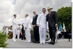 Vice President Dick Cheney poses for a photograph with a U.S. Coast Guard Academy graduate, Wednesday, May 21, 2008, during commencement exercises in New London, Conn. White House photo by David Bohrer