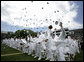 U.S. Coast Guard Academy graduates toss their hats into the air in celebration, Wednesday, May 21, 2008 during commencement ceremonies in New London, Conn. White House photo by David Bohrer