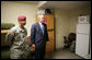 President George W. Bush is given a tour of a 82nd Airborne Division barracks room by 1st Sgt. David Santos, during the President's visit Thursday, May 22, 2008 in Fort Bragg, N.C., for the 82nd Airborne Division review. White House photo by Chris Greenberg