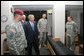 President George W. Bush talks with soldiers during his tour of the 82nd Airborne Division barracks rooms and facilities Thursday, May 22, 2008 in Fort Bragg, N.C., on his visit to attend the 82nd Airborne Division review. White House photo by Chris Greenberg