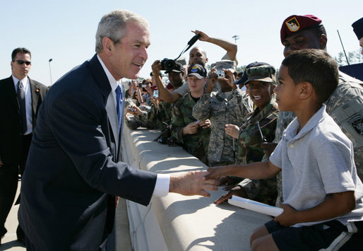 President George W. Bush greets a young boy on his arrival to Pope Air Force Base in Fort Bragg, N.C., Thursday, May 22, 2008. White House photo by Chris Greenberg