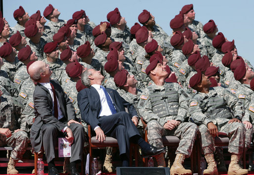 President George W. Bush and U.S. Army Secretary Pete Geren watch members of the U.S. Army's 82nd AIrborne Division parachute onto the field during the President's visit Thursday, May 22, 2008 to Fort Bragg, N.C., for the 82nd Airborne Division Review. White House photo by Chris Greenberg