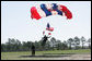 A member of U.S. Army's 82nd Airborne Division parachute team lands on the parade field during the President George W. Bush's visit Thursday, May 22, 2008 to Fort Bragg, N.C., on the occassion of the 82nd Airborne Division Review. White House photo by Chris Greenberg