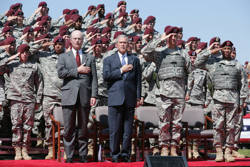 President George W. Bush and U.S. Army Secretary Pete Geren stand during the playing of the National Anthem Thursday, May 22, 2008 in Fort Bragg, N.C., for the 82nd Airborne Division Review. White House photo by Chris Greenberg