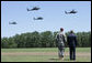 President George W. Bush, joined by Maj. Gen. David Rodriguez, watches a formation of helicopters fly pass during a troop review ceremony Thursday, May 22, 2008, during the President's visit to Fort Bragg, N.C. White House photo by Chris Greenberg
