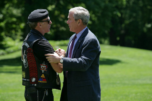 President George W. Bush greets Artie Muller, the National Executive Director of Rolling Thunder on the South Lawn of the White House. White House photo by Chris Greenberg