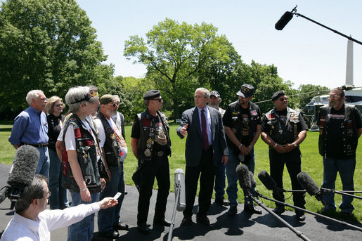 President George W. Bush stands with National Executive Director of Rolling Thunder Artie Muller and other members as he gives a statement to the press about the importance of the work the motorcycle riders do on behalf of the military. White House photo by Chris Greenberg