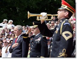 President George W. Bush is accompanied by Major General Richard J. Rowe Jr., commander of the Military District of Washington, right, as he holds his hand over his heart during the playing of taps at the Tomb of the Unknowns during a Memorial Day ceremony Monday, May 26, 2008 at Arlington National Cemetery in Arlington, VA. White House photo by Chris Greenberg