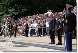 Pausing for a moment of silence, President George W. Bush is accompanied by Major General Richard J. Rowe Jr., commander of the Military District of Washington, right, after laying a wreath at the Tomb of the Unknowns Monday, May 26, 2008, during a Memorial Day ceremony at Arlington National Cemetery in Arlington, VA. White House photo by Chris Greenberg