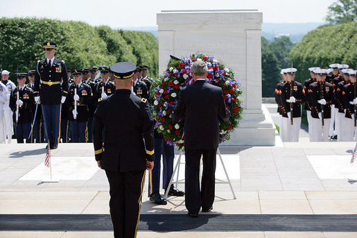 President George W. Bush, accompanied by Major General Richard J. Rowe Jr., commander of the Military District of Washington, foreground left, lays a wreath at the Tomb of the Unknowns Monday, May 26, 2008, during a Memorial Day ceremony at Arlington National Cemetery in Arlington, VA. White House photo by Shealah Craighead