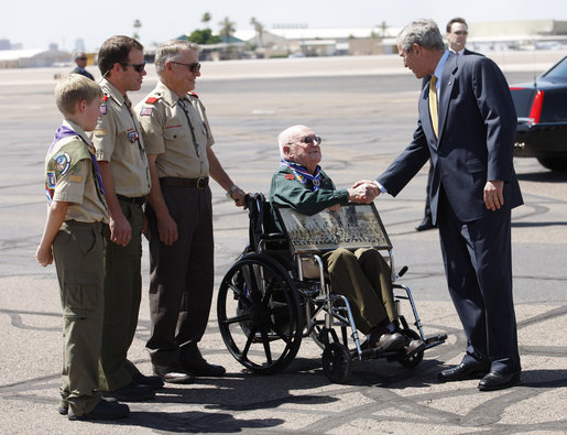 President George W. Bush greets four generations of Eagle Scouts, from right, Tom Boggess Jr., Tom Boggess III, Tom Boggess IV, and Tom Boggess V after arriving in Phoenix, Arizona, Tuesday, May 27, 2008. White House photo by Eric Draper