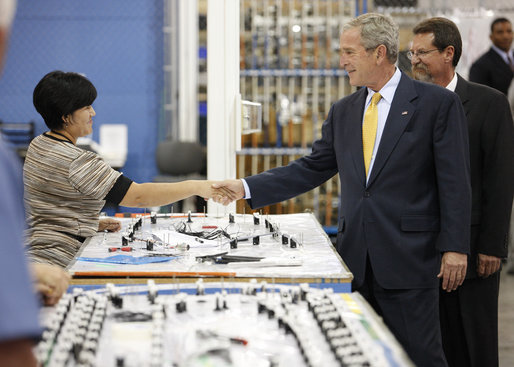 President George W. Bush greets an employee during his visit to Silverado Cable Company in Mesa, Arizona, Tuesday, May 27, 2008. White House photo by Eric Draper