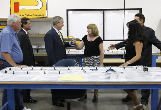 President George W. Bush greets employees while touring the production floor at the Silverado Cable Company in Mesa, Arizona, Tuesday, May 27, 2008. White House photo by Eric Draper
