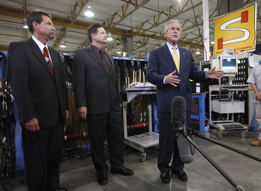 President George W. Bush delivers a statement to the media following his tour of the production floor at the Silverado Cable Company in Mesa, Arizona, Tuesday, May 27, 2008. Also pictured are Bob Simpson Jr. President of Silverado Cable Company and Mitch Simpson, Vice President of Silverado Cable Company. White House photo by Eric Draper