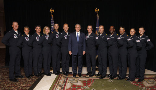 President George W. Bush poses for a photo Wednesday, May 28, 2008 with members of the 2008 Thunderbirds, the United States Air Force Air Demonstration Squadron, prior to President Bush's commencement address at the U.S. Air Force Academy in Colorado Springs. From left to right, Thunderbirds commander/leader Lt. Col. Greg Thomas, Maj. Charla Quayle, Lt. Col. Rob Skelton, Maj. Samantha Weeks, Maj. Kirby Ensser, Capt. Gifford Ploetz, Maj. Chris Austin, Maj. Scott Poteet, Maj. T. Dyon Douglas, Maj. Tony Mulhare, Capt. Amy Glisson and Capt. Elizabeth Kreft. White House photo by Eric Draper